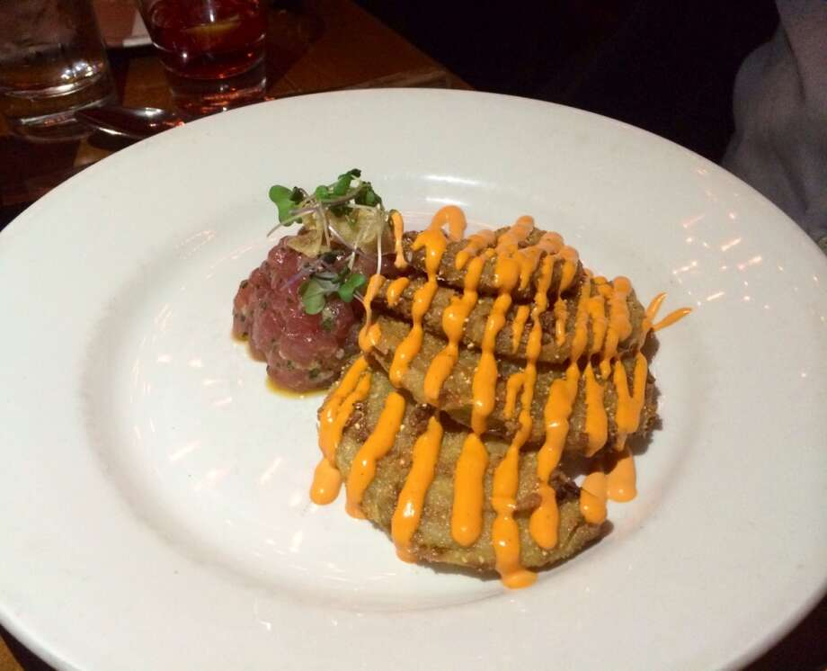 Tuna tartare with fried green tomatoes  with a Tabasco green onion vinaigrette ($16)