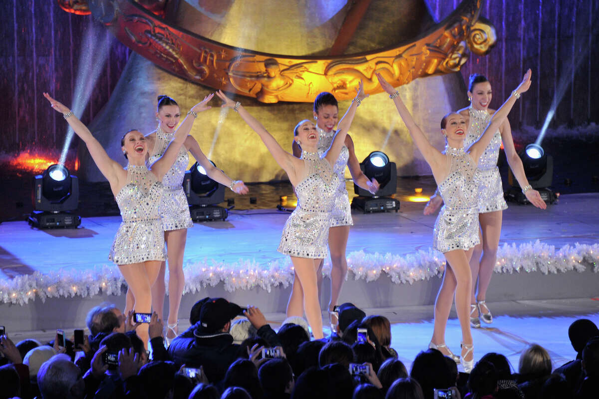 """NEW YORK, NY - DECEMBER 04: Members of the musical """"Rockettes"""" perform during 81st Annual Rockefeller Center Christmas Tree Lighting Ceremony at Rockefeller Center on December 4, 2013 in New York City."""