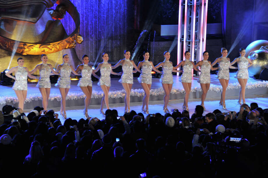 "NEW YORK, NY - DECEMBER 04:  Members of the musical ""Rockettes"" perform during 81st Annual Rockefeller Center Christmas Tree Lighting Ceremony at Rockefeller Center on December 4, 2013 in New York City. Photo: Stephen Lovekin, Getty Images / Getty Images"