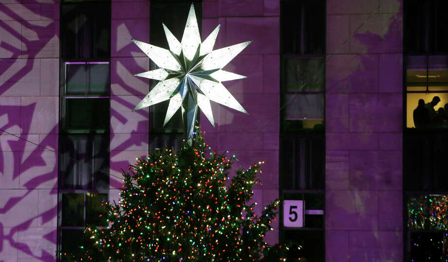 The Swarovski star shines atop the Rockefeller Center Christmas tree after it was lit during a ceremony, Wednesday, Dec. 4, 2013, in New York. Some 45,000 energy efficient LED lights adorn the 76-foot tree. Photo: Kathy Willens, AP / Associated Press