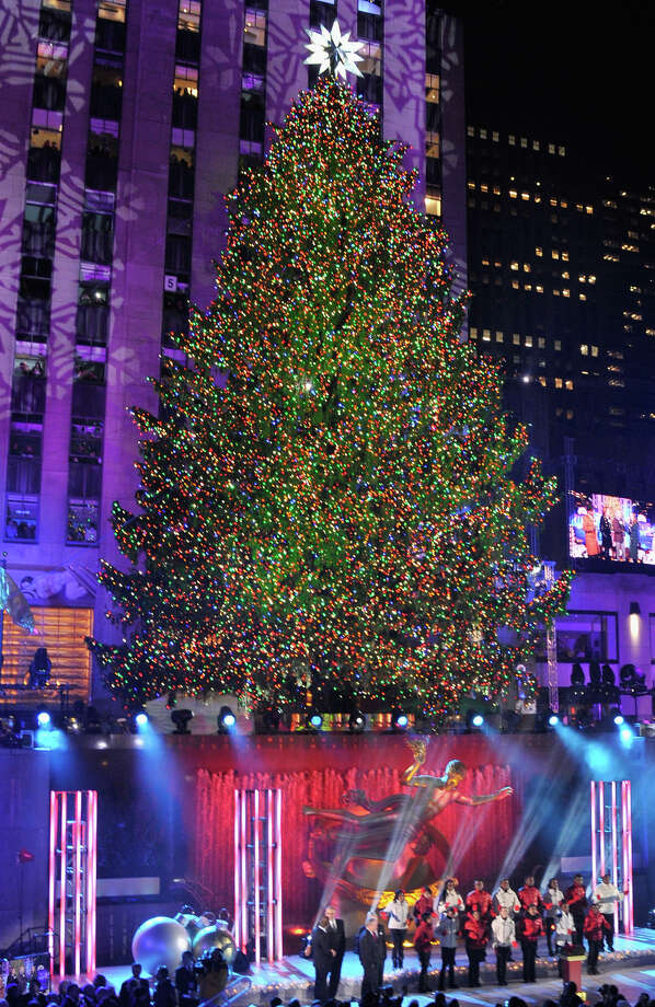 NEW YORK, NY - DECEMBER 04:  The Christmas Tree is lit during 81st Annual Rockefeller Center Christmas Tree Lighting Ceremony at Rockefeller Center on December 4, 2013 in New York City. Photo: Stephen Lovekin, Getty Images / Getty Images