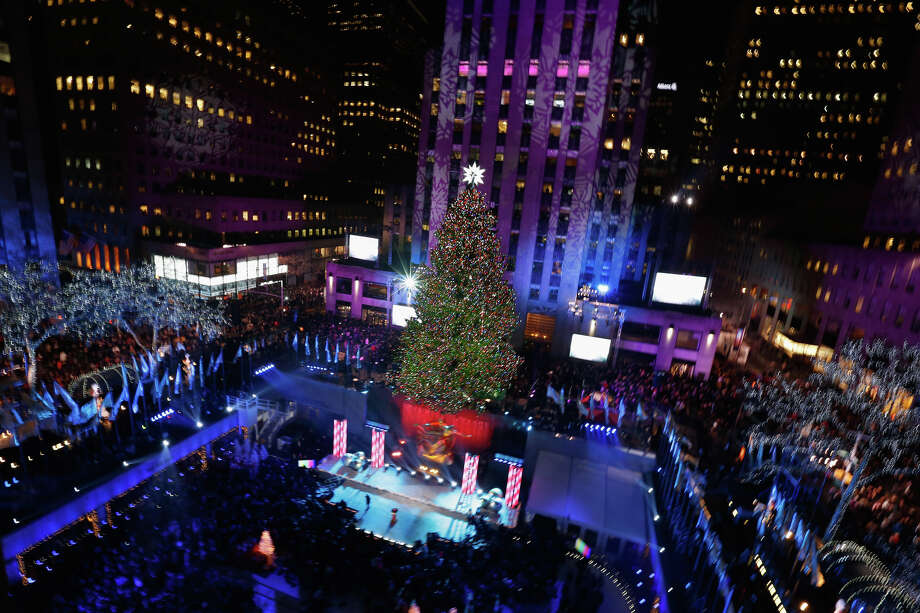 NEW YORK, NY - DECEMBER 04:  The Christmas Tree is lit during 81st Annual Rockefeller Center Christmas Tree Lighting Ceremony at Rockefeller Center on December 4, 2013 in New York City. Photo: Jemal Countess, Getty Images / Getty Images
