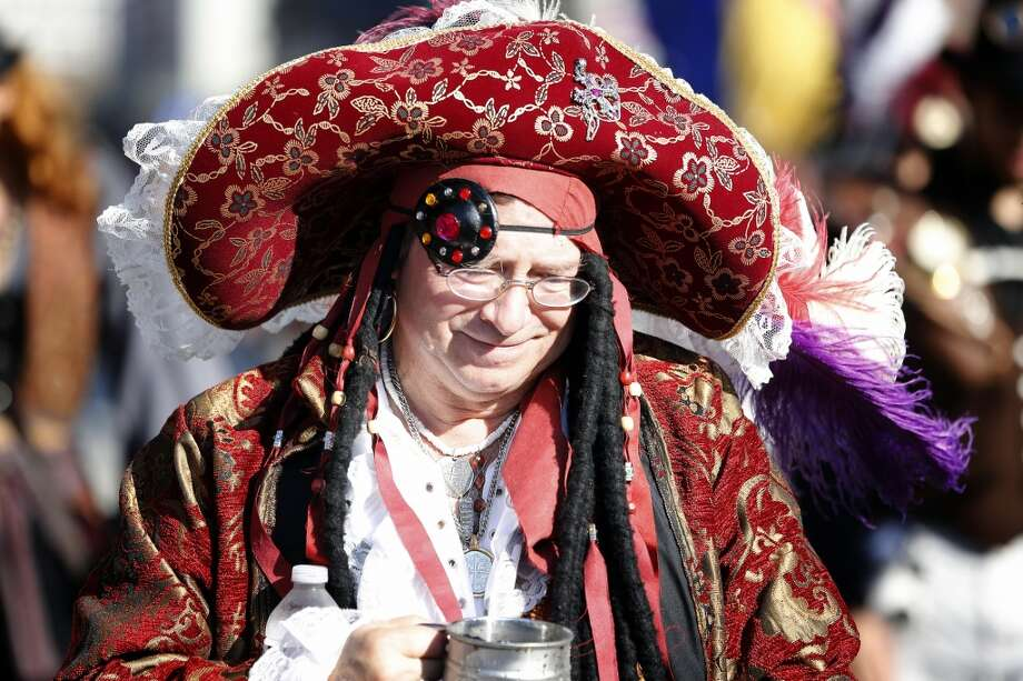 A man dressed as a pirate walks the parade route, Saturday, December 1, 2012 during the annual Dickens on The Strand celebration in Galveston, Texas. (Todd Spoth / For The Chronicle) Photo: Houston Chronicle