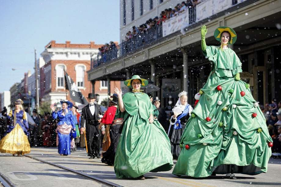 Costumers walk the parade route Saturday, December 1, 2012 during the annual Dickens on The Strand celebration in Galveston, Texas. (Todd Spoth / For The Chronicle) Photo: Houston Chronicle