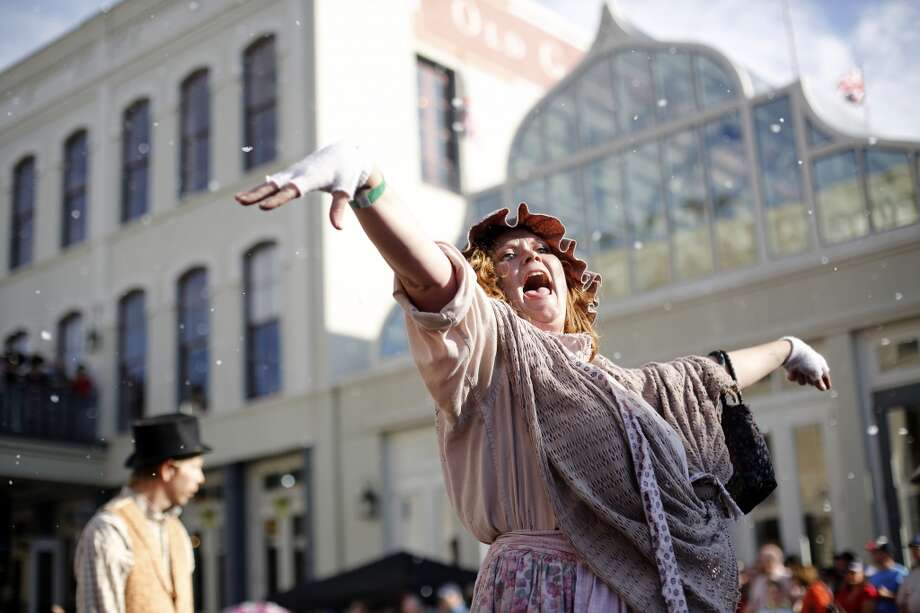 A woman dressed as a Victorian era beggar walks the parade route, Saturday, December 1, 2012 during the annual Dickens on The Strand celebration in Galveston, Texas. (Todd Spoth / For The Chronicle) Photo: Houston Chronicle
