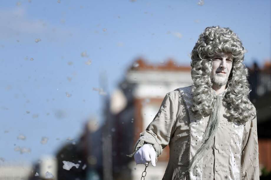 A performer dressed as a ghost from Charles Dickens' A Christmas Carol, walks the parade route, Saturday, December 1, 2012 during the annual Dickens on The Strand celebration in Galveston, Texas. (Todd Spoth / For The Chronicle) Photo: Houston Chronicle