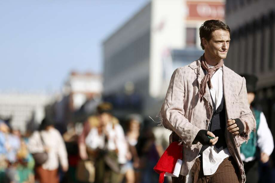 A man dressed as a Victorian era beggar walks the parade route, Saturday, December 1, 2012 during the annual Dickens on The Strand celebration in Galveston, Texas. (Todd Spoth/For The Chronicle) Photo: Houston Chronicle