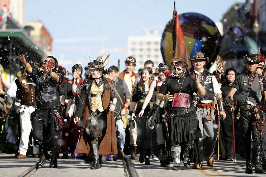 A contingent of steampunk enthusiasts parade down The Strand, Saturday, December 1, 2012 during the annual Dickens on The Strand celebration in Galveston, Texas. (Todd Spoth / For The Chronicle) Photo: Houston Chronicle