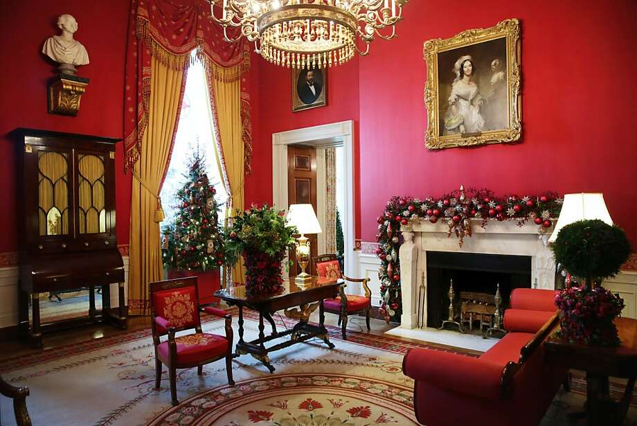 Holiday decorations are displayed in the Red Room of the White House during an event to preview the 2013 holiday decorations December 4, 2013 in Washington, DC. U.S. first lady Michelle Obama hosted military families for the first viewing of the decorations and demonstrating holiday crafts and treats to military children. Photo: Alex Wong, Getty Images