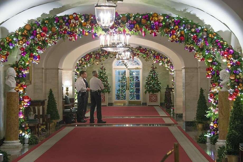 Decorations hang in the hallway off the China Room at the White House in Washington, DC, December 4, 2013 during the White House Christmas decorations viewing. Photo: Jim Watson, AFP/Getty Images