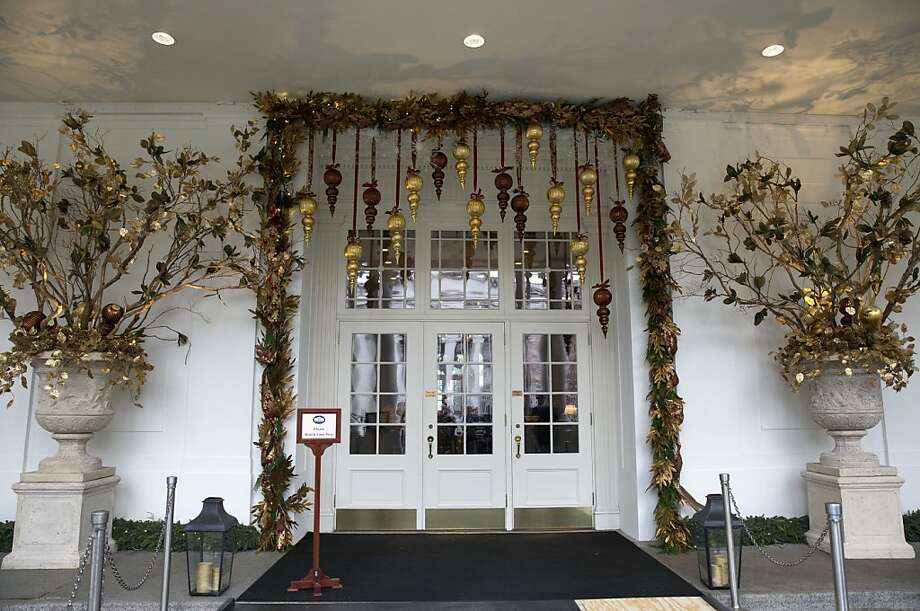 """Holiday decorations by the East Visitor Entrance of the White House in Washington, on Wednesday, Dec. 4, 2013, the theme this year is """"Gather Around."""" Photo: Jacquelyn Martin, Associated Press"""