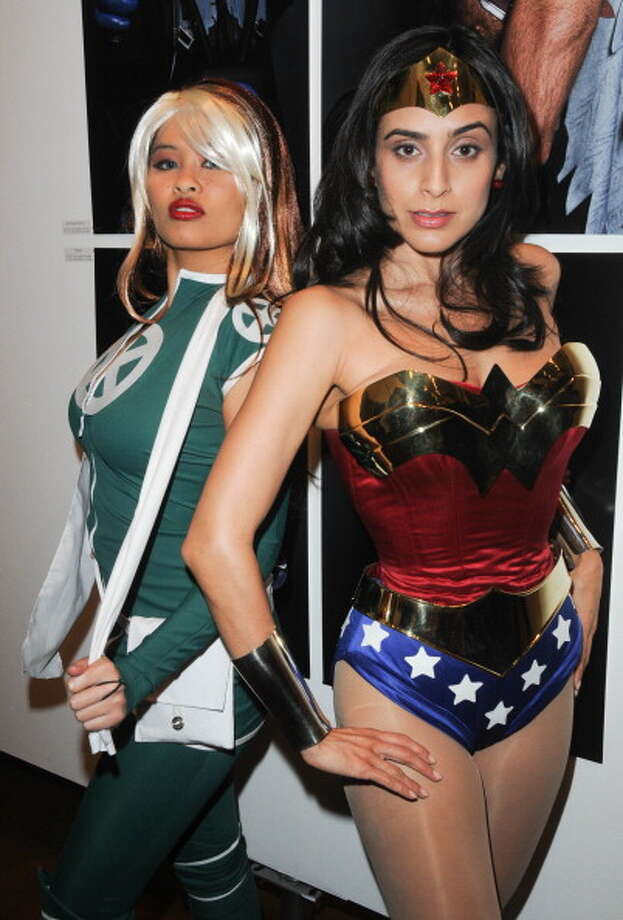 Cosplayers Tracy as Rogue and Valerie Perez as Wonder Woman participate in the Opening Night Of Cosplay In America Exhibition held at The Icon on October 28, 2011 in Los Angeles, Calif. Photo: Albert L. Ortega, Getty Images / 2011 Albert L. Ortega