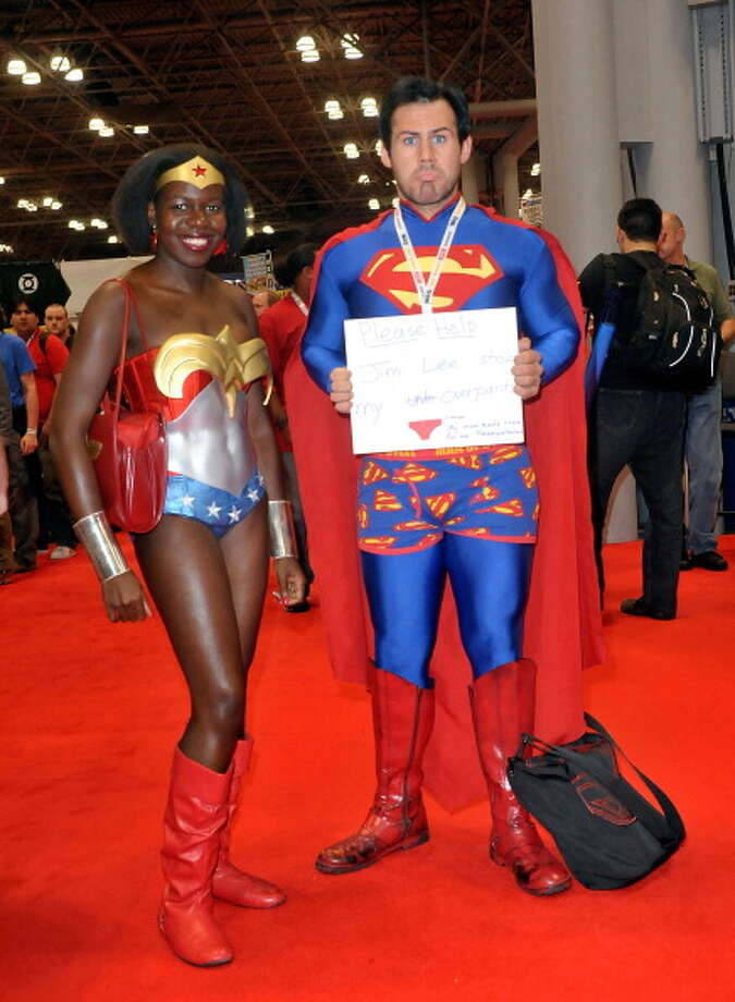 Comic Con attendees wearing Wonder Woman and Superman costumes pose during the 2012 New York Comic Con at the Javits Center on October 11, 2012 in New York City. Photo: Daniel Zuchnik, Getty Images / 2012 Getty Images