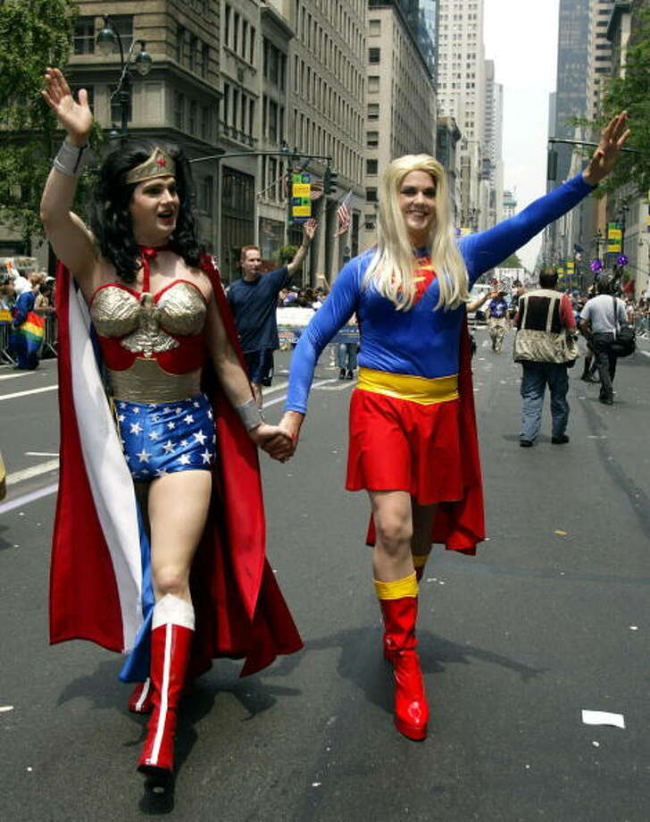Two men dressed as Wonder Woman (L) and Super-Girl (R) wave to the crowd gathered on Fifth Avenue 29 June, 2003 during the Heritage of Pride parade in New York. Photo: DON EMMERT, AFP/Getty Images / 2003 AFP