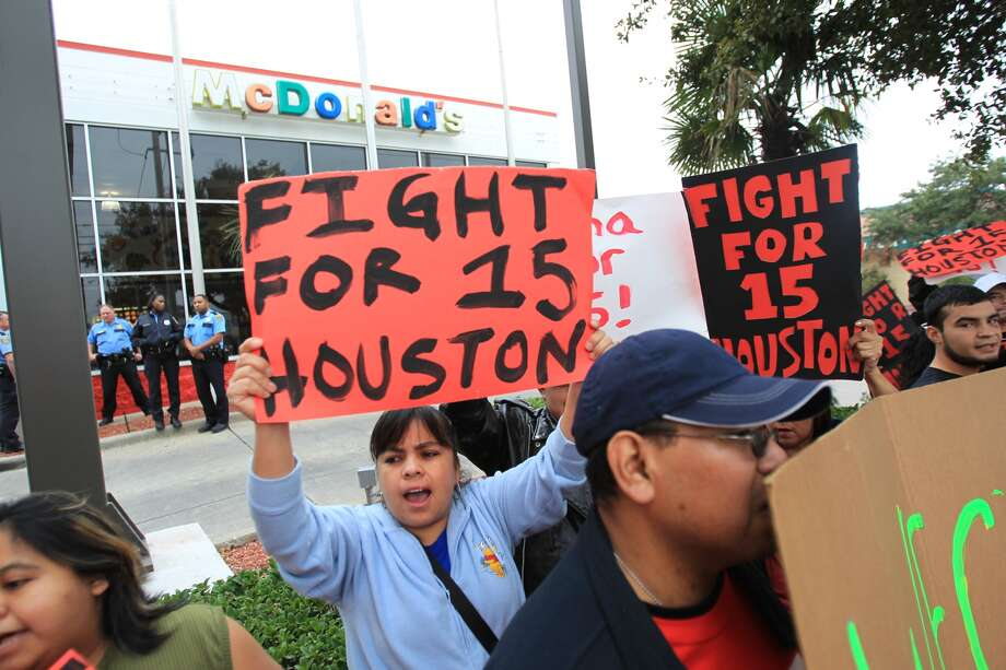 Minimum wage workers across the country are demanding $15 per hour. See which Houston professions pay less than what minimum wage workers are demanding. Photo: Mayra Beltran, Houston Chronicle