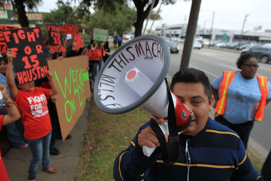 Fast food workers and supporters protest outside the McDonald's at Kirby and 59 as part of the Fight For 15 national campaign on Dec. 5, 2013. ( Mayra Beltran / Houston Chronicle ) Photo: Mayra Beltran, Houston Chronicle
