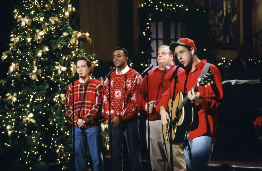 "Saturday Night Live's Rob Schneider, Tim Meadows, Chris Farley and Adam Sandler donned some ugly during the ""Santa Don't Like Bad Boys"" skit on Dec. 11, 1993. Farley actually looks pretty good. Photo: NBC, Getty Images / © NBCUniversal, Inc."