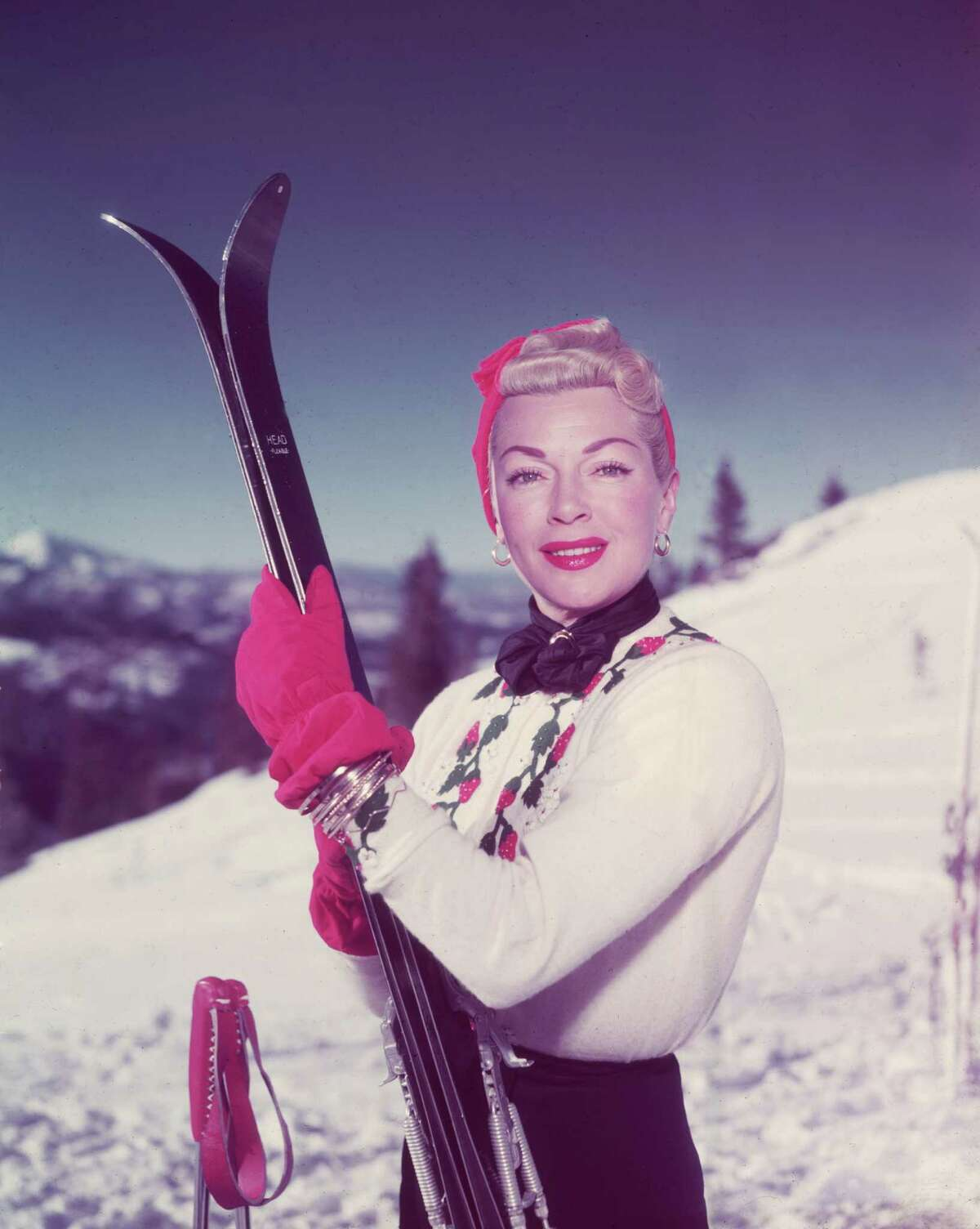 That'd be Lana Turner. The sweater is find, but the matching gloves-ski poles combo is really something.