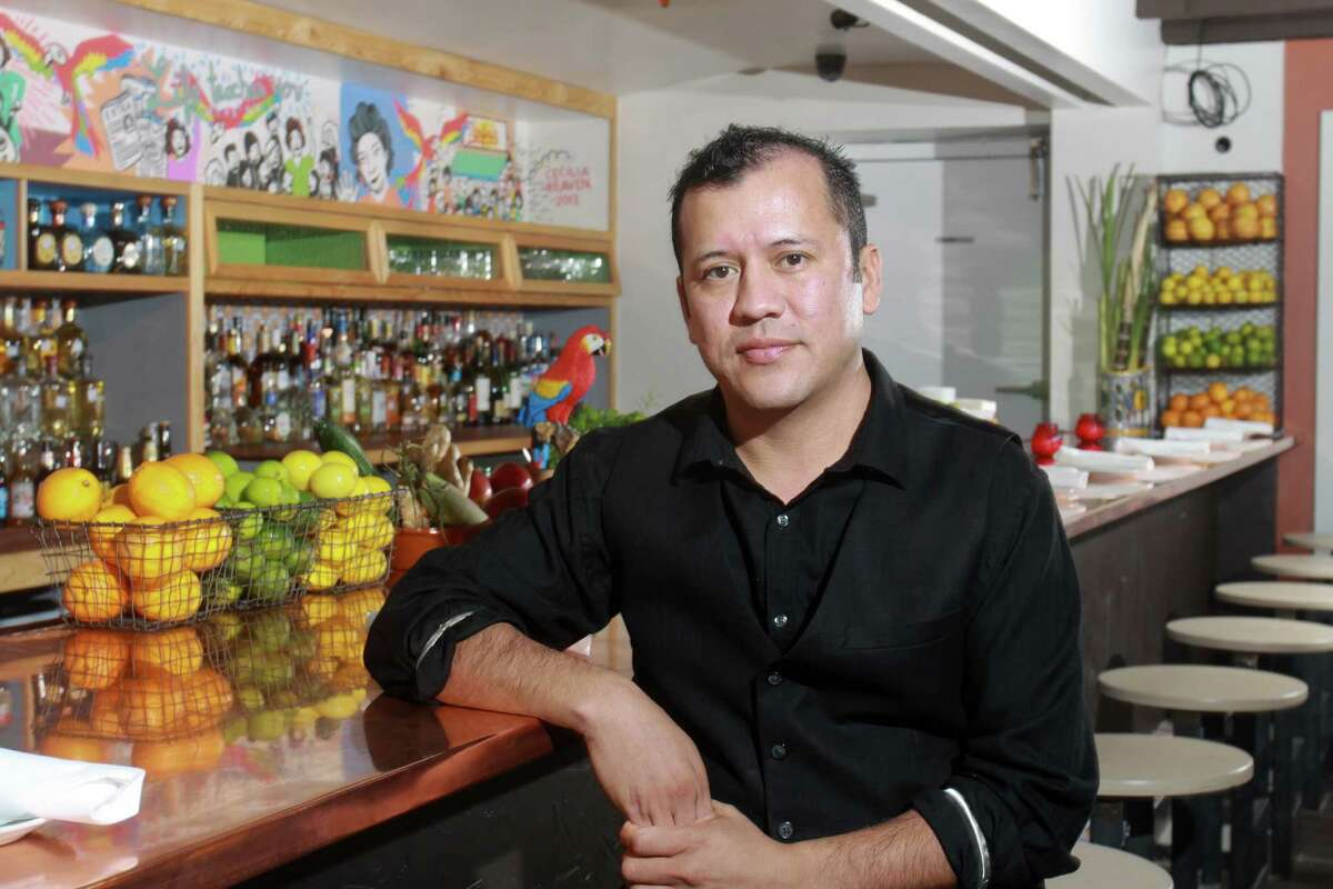 (For the Chronicle/Gary Fountain, November 25, 2013) Nelson Serrano, bar manager at Ninfa's on Navigation, at the bar in the new enclosed patio.