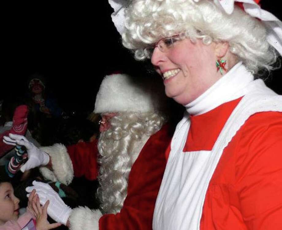 Santa and Mrs. Claus will be back in town Friday night at the town's Christmas tree lighting. Photo: Genevieve Reilly / Fairfield Citizen
