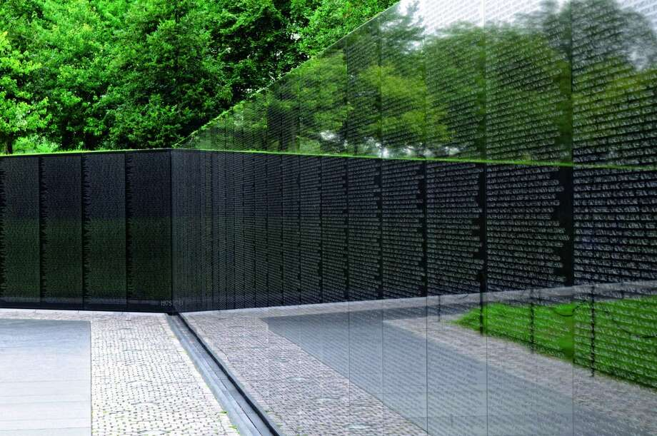 "Washington, D.C.:Maya Lin's design for the Vietnam Veterans Memorial, which initially met with controversy but is now a national icon, includes the names of all those killed in action in Vietnam. The U.S. Holocaust Memorial Museum and the National Gallery of Art are the two other D.C. destinations in ""Art & Place: Site-Specific Art of the Americas"" (Phaidon 2013). Photo: © Maya Lin Studio/ David Coleman / , Www.phaidon.com"