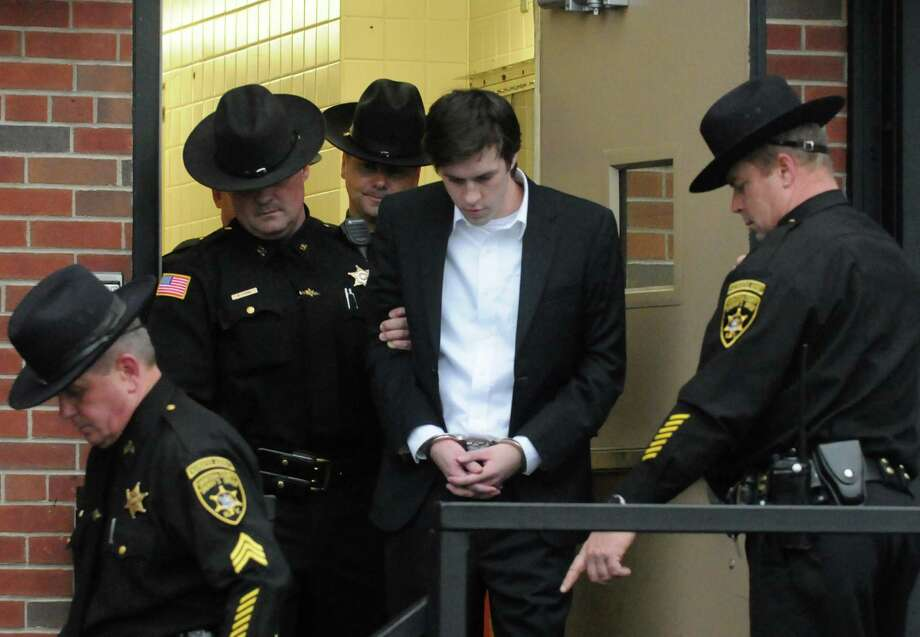 Dennis Drue is lead out of the Saratoga County Court House by Saratoga Sheriff deputies following his sentencing Thursday afternoon, Dec. 5, 2013, in Ballston Spa, N.Y. Drue was sentenced to 5-15 years after pleading guilty to felony charges regarding the Northway crash which killed Chris Stewart and Deanna Rivers just over a year ago. (Michael P. Farrell/Times Union) Photo: Michael P. Farrell / 00024829A