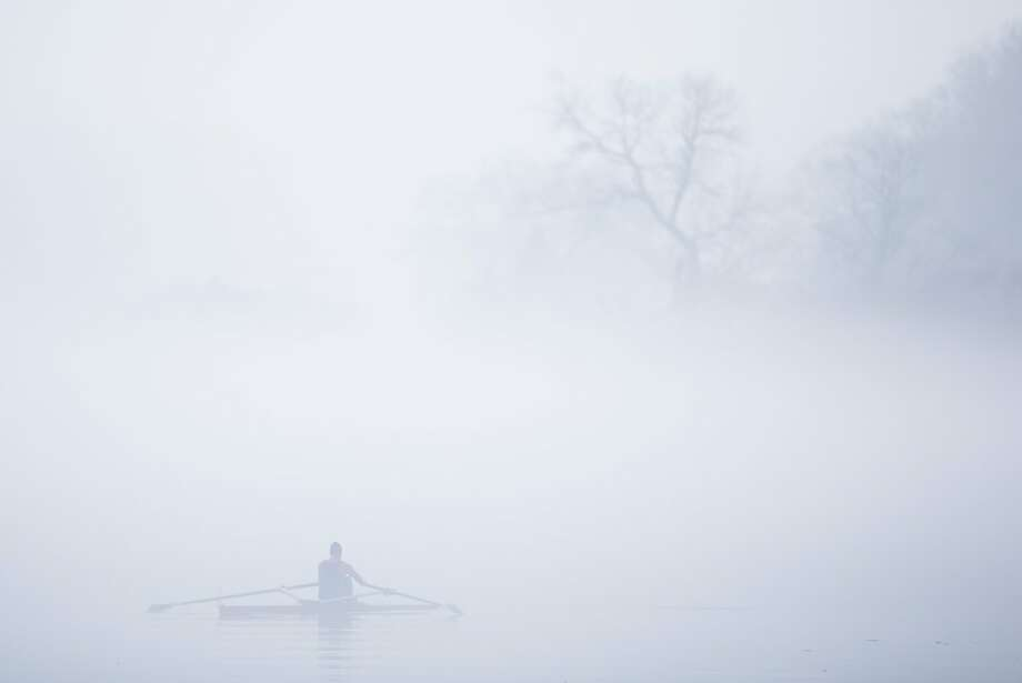 Should have brought my GPS:Thick fog blankets a rower on the Schuylkill River in Philadelphia. Photo: Matt Rourke, Associated Press