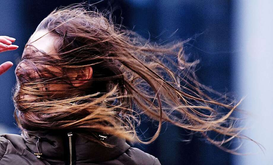 A windstorm plays havoc with a hairdo in Rotterdam. The storm, dubbed Xaver, battered northern Europe Thursday, 