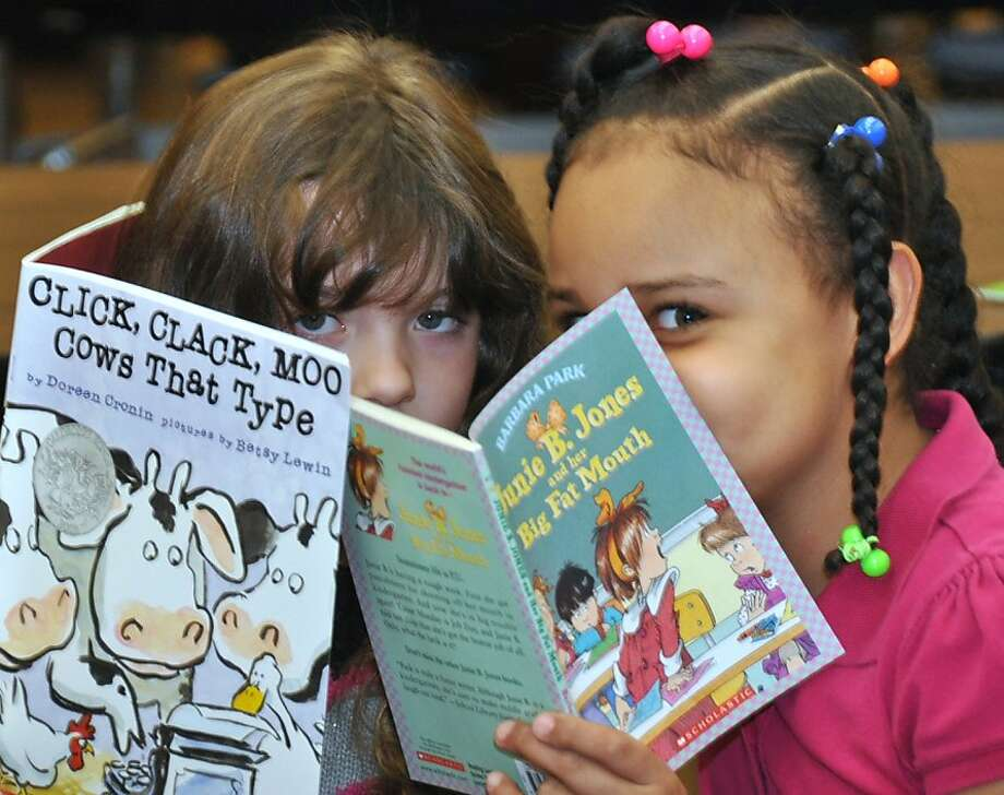 She opened her 'Big Fat Mouth' book:In Hazleton, Pa., first-grader Giada Barletta (left) shares a secret with   classmate Angelica Martinez Cruz, whose reading material suggests she may not be the best person to confide   in. Photo: Ellen F. O'Connell, Associated Press