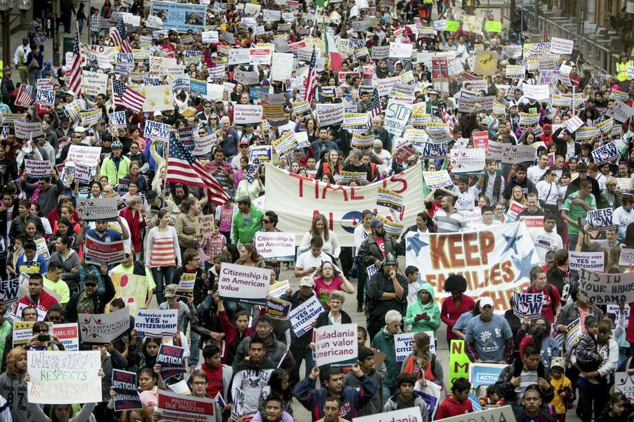 Demonstrators rally for immigration reform in Minneapolis in October. Momentum is gathering to grant undocumented immigrants already here some status short of a shot at citizenship. That idea is problematic. Photo: Jenn Ackerman / New York Times