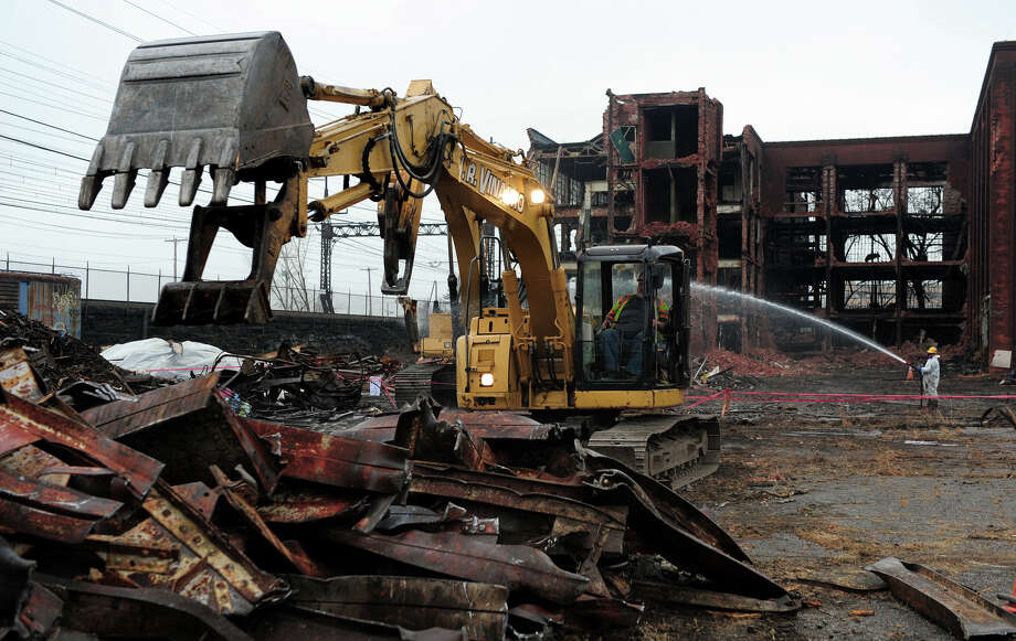 Demolition crews at work at the former Remgrit site on Barnum Avenue in Bridgeport, Conn. on Thursday December 5, 2013. Mayor Bill Finch announced that the site may be the future home of a second train station for the city. Photo: Christian Abraham / Connecticut Post