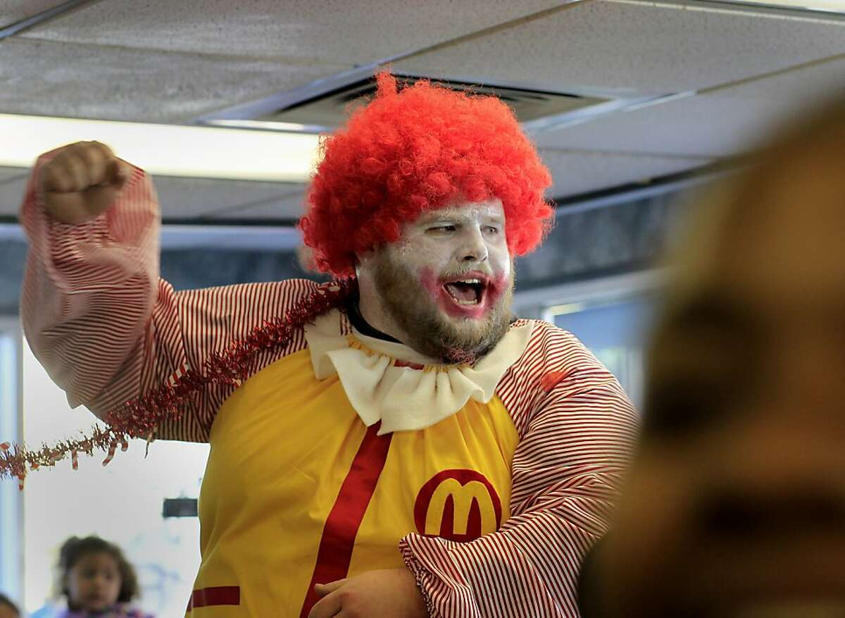 A man dressed as Ronald McDonald led a chant in the restaurant Thursday December 5, 2013 in Oakland, Calif. On a day of national protest against the wages paid to fast food workers, dozens protested in front of a McDonalds on Jackson Street and entered the restaurant.