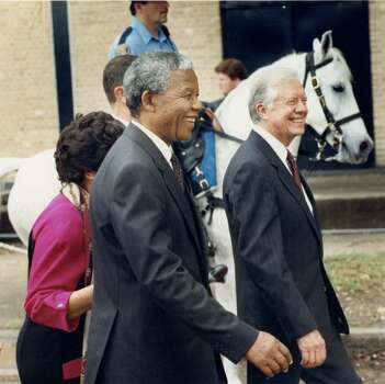 12/08/1991 - Former President Jimmy Carter and Nelson Mandela walk to lunch on the campus of St. Thomas University after the presentation of the Carter-Menil award. Dec. 8, 1991 Photo: Jerry Click, Houston Post File