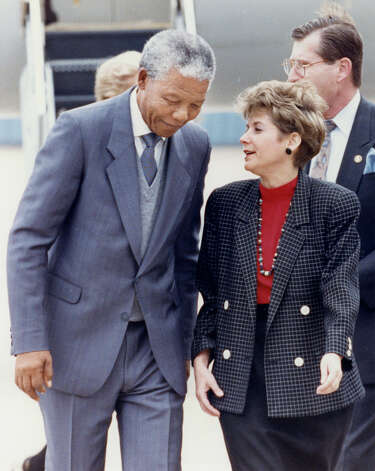 Nelson Mandela is greeted by outgoing Houston mayor Kathy Whitmire on his arrival at Hobby Airport.. Dec. 7, 1991 Photo: Craig H. Hartley, Houston Post File
