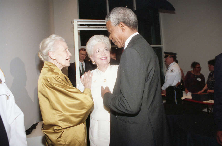 Dominique de Menil escorts Nelson Mandela and Texas Gov. Ann Richards through the Menil Collection, explaining various pieces of art, during a pre-dinner reception Saturday, Dec. 7, 1991. Photo: Paul S. Howell, Chronicle File