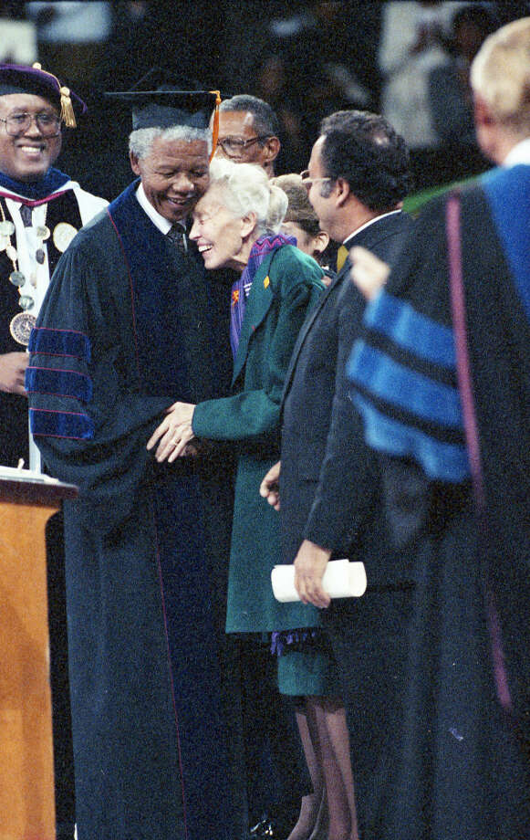 Nelson Mandela gets a hug from Dominique de Menil after receiving his honorary degree from Texas Southern University, Dec. 8, 1991. Photo: Paul S. Howell, Chronicle File