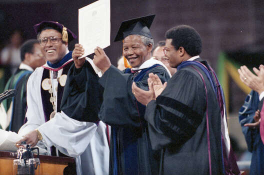 Nelson Mandela displays the honorary degree awarded him by Texas Southern University. With him are TSU President William H. Harris and regents Chairman Rufus Cormier Photo: Paul S. Howell, Chronicle File