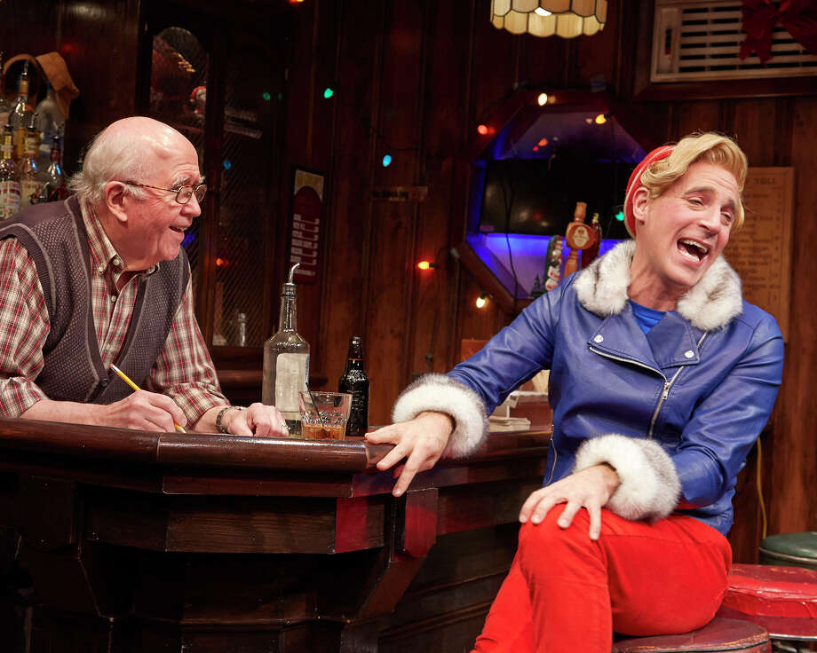 """A bartender (Ronn Carroll) listens to the troubles of Hermes the Elf (Harry Bouvy) in the new comedy """"Christmas on the Rocks"""" at TheaterWorks Hartford, through Dec. 22. Photo: Contributed Photo / Connecticut Post Contributed"""