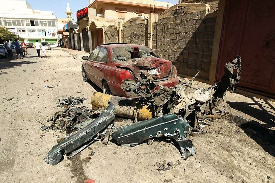 A destroyed car and the remains of car bomb are seen following an explosion outside the Swedish consulate in the eastern Libyan city of Benghazi on October 11, 2013 which seriously damaged the building but caused no casualties. The Swedish mission is one of the few remaining diplomatic offices remaining in Benghazi, which was the cradle of uprising and frequently sees attacks on security personnel and institutions. Photo: Abdullah Doma, AFP/Getty Images