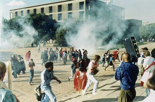 Clouds of teargas send students scurrying when police were sent to the University of Witwatersrand Campus in Johannesburg to disperse a gathering May 4, 1987. The police were acting under a last minute court order banning an open air meeting at which Winnie Mandela, wife of Nelson, jailed leader of the ANC, was to address the crowd of about 6000. Photo: JOHN PARKIN, Wire / AP1987