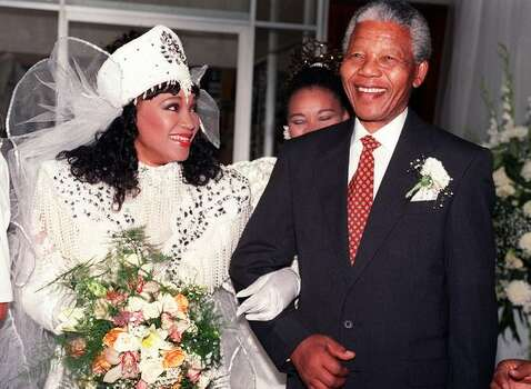Zinzi Mandela (l), daughter of South African National Congress (ANC) President Nelson Mandela, wearing Xhosa traditional outfit, and her father Nelson, smile, 26 October 1992 in Soweto, after Zinzi married Zweli Hlongwane, a black businessman. Photo: Getty Images