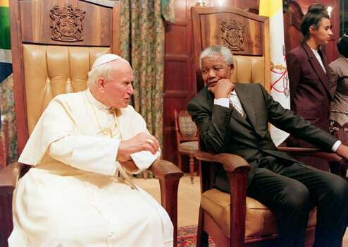 Pope John Paul II and South African President Nelson Mandela talkat the Presidential guest house in Pretoria. The pontiff visited Cameroon, South Africa and Nairobi for the conclusion of the Special Assembly for Africa of the Synod of Bishops. Photo: Getty Images