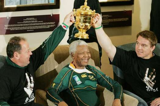 Former South Africa President Nelson Mandela poses with South Africa Rugby Union coach Jake White (L), South Africa Rugby Union captain John Smit (R) and the Webb-Ellis cup during the Springboks visit to Nelson Mandela at his residence on October 27, 2007 in Houghton, Johannesburg, South Africa. South Africa became the current holders of the cup after defeating Former champions England 15-6 in the 2007 Rugby World Cup Final. Photo: Getty Images