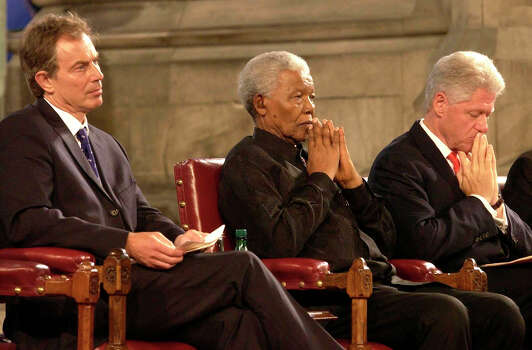 British Prime Minister Tony Blair, left, former South African President Nelson Mandela, center, and former US President Bill Clinton pause during a gala night to mark the centenary of the Rhodes Trust and the establishment of the Mandela Rhodes Foundation, at Westminster Hall, London Wednesday July 2, 2003. Photo: CHRIS YOUNG, Wire / PA