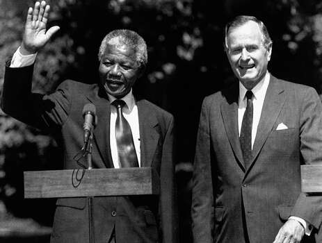 President George Bush greets South African leader Nelson Mandela on the South Lawn of the White House, Monday, June 26, 1990, Washington, DC. Mandela told Bush the support blacks in South Africa have received from the United States, particularly economic sanctions, have been crucial promoting changes in his country. Photo: Doug Mills, Wire / 1990 AP