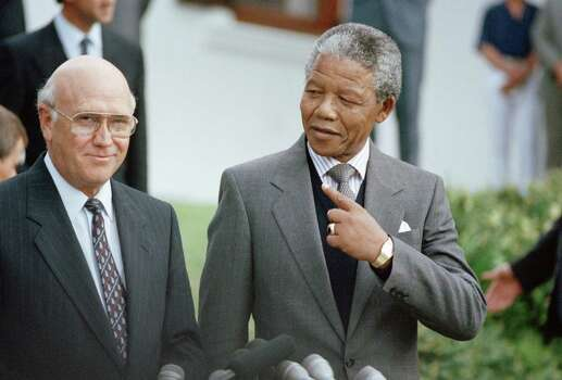 South African State President F W de Klerk, left,  and Deputy President of the African National Congress Nelson Mandela, right,  at a photocall on Wednesday, May 2, 1990 in Cape Town, South Africa, prior to meeting for talks which will last till Friday. Photo: Denis Farrell, Wire / AP1990