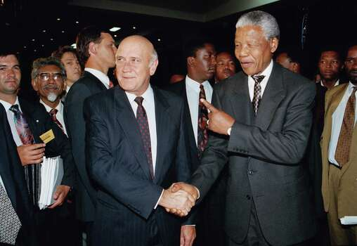 President F.W. de Klerk shakes hands with African National congress President Nelson Mandela at the World Trade Centre near Johannesburg, on Thursday, Nov. 18, 1993. The two leaders met after negotiators finished work on an interim constitution and bill of rights for a post-apartheid South Africa. Photo: David Brauchli, Wire / AP1993