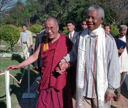 Tibetan leader the Dalai Lama, left, meets with President Nelson Mandela, right, in Cape Town South Africa. South Africa said Monday, March 23, 2009,  it wanted to avoid being the source of bad publicity about trading partner China, and ended up itself the target of sharp criticism for barring the Dalai Lama from a peace conference in Johannesburg later this week. Photo: SASA KRALJ, Wire / 1996 AP