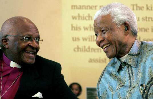 Former South African President Nelson Mandela, right, reacts with Archbishop Desmond Tutu, left, during the launch of a Walter and Albertina Sisulu exhibition, called, 'Parenting a Nation', at the Nelson Mandela Foundation in Johannesburg, South Africa, Wednesday, March 12, 2008. Photo: Themba Hadebe, Wire / 2008 AP