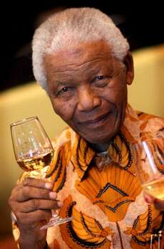 Nelson Mandela raises a glass during a lunch to Benefit the Mandela Children's Foundation as part of the celebrations of the opening of the new One&Only Cape Town resort on April 3, 2009 in Cape Town, South Africa. The One&Only is Sol Kerzner's first hotel in his home country since 1992. The 130 room property is One&Only's first Urban resort and sits in the fashionable Waterfront district. Celebrities from all over the world including Mariah Carey, Clint Eastwood, Matt Damon, Morgan Freeman, Thandie Newton, Marisa Tomei will attend the event. Gordon Ramsay will be launching his first restaurant in Africa at the resort, Maze and Robert De Niro will be opening Nobu. Nelson Mandela will be attending an intimate luncheon at Maze on Friday to celebrate his long-standing relationship with Mr. Kerzner. Photo: Getty Images